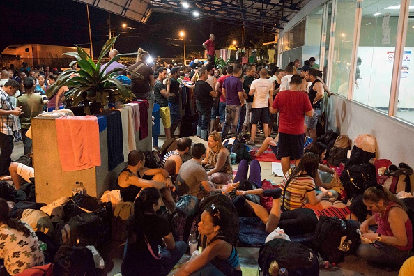 Cubans waiting in Costa Rica on their way to Mexico and then into the United States. EZEQUIEL BECERRA/AFP/Getty Images)