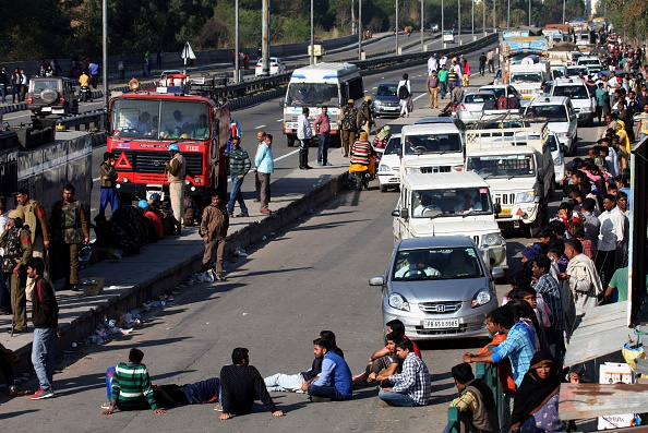 Indian residents from the Jat community block the Chandigarh-Shimla highway amid violent caste protests in Panchkula on February 21, 2016. STRDEL/AFP/Getty Images)
