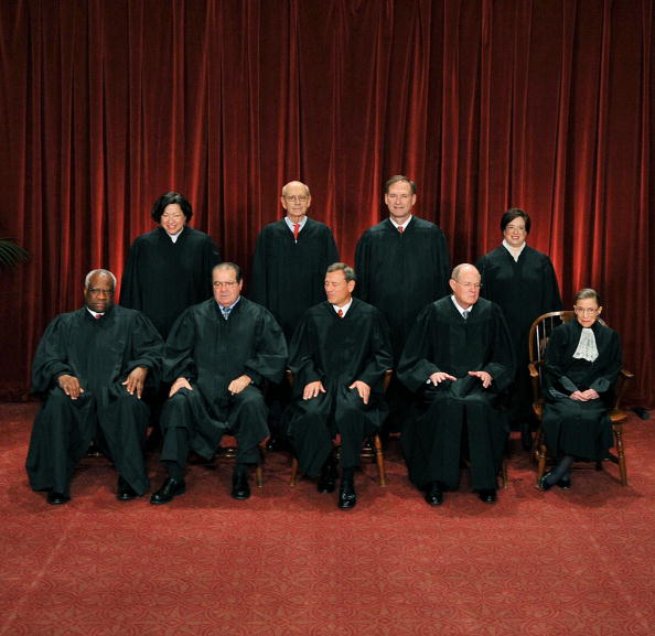 The Late Justice, Antonin Scalia, is second from the left in the front row.TIM SLOAN/AFP/Getty Images)