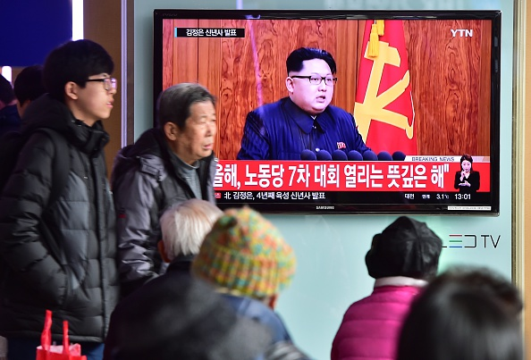 Commuters walk past a television screen showing a broadcast of North Korean leader Kim Jong-Un's New Year speech, at a railroad station in Seoul on January 1, 2016. North Korean leader Kim Jong-Un said raising living standards was his number one priority in an annual New Year's address on January 1 that avoided any explicit reference to the country's nuclear weapons programme. AFP PHOTO / JUNG YEON-JE / AFP / JUNG YEON-JE (Photo credit should read JUNG YEON-JE/AFP/Getty Images)