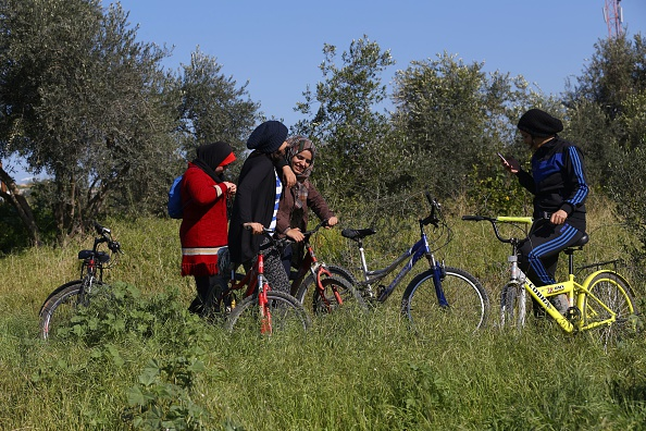 Young Palestinian women cyclists take a break in Beit Hanun in the northern Gaza Strip. MOHAMMED ABED/AFP/Getty Images)