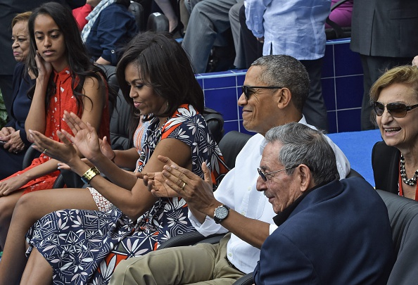 US President Barack Obama his family and Cuban President Raul Castro look on before the start of a baseball game between the Tampa Bay Rays and the Cuban national team. March 22, 2016. Credit NICHOLAS KAMM/AFP/Getty Images