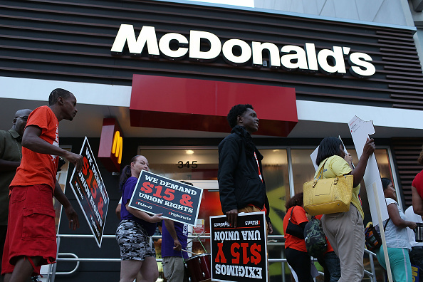 Workers protest outside a McDonald's restaurant. Photo by Joe Raedle/Getty Images