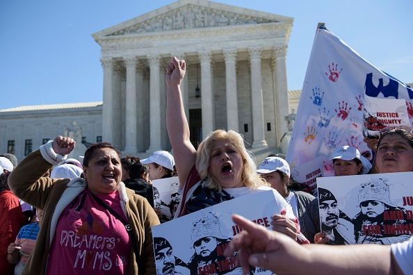 Activists gather during a rally outside the US Supreme Court a month before the court will hear the case US v Texas. BRENDAN SMIALOWSKI/AFP/Getty Images)
