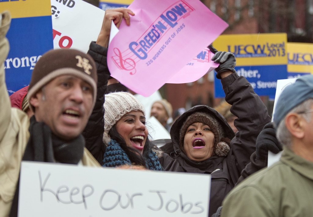 Cumberland Packing Corp. employees and union representatives protest Cumberland's closure in New York. Photo credit: AP Photo/Mary Altaffer)