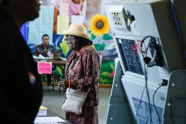 A woman registers her name to cast her ballot during Pennsylvania's primary election on April 26, 2016. Photo credit EDUARDO MUNOZ ALVAREZ/AFP/Getty Images