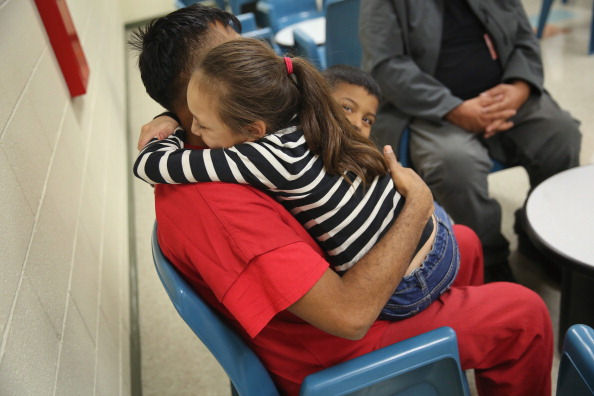 A family at the Adelanto, California Detention Facility. Photo by John Moore/Getty Images