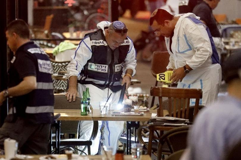 Israeli forensic police examine evidence in the shooting in Tel Aviv