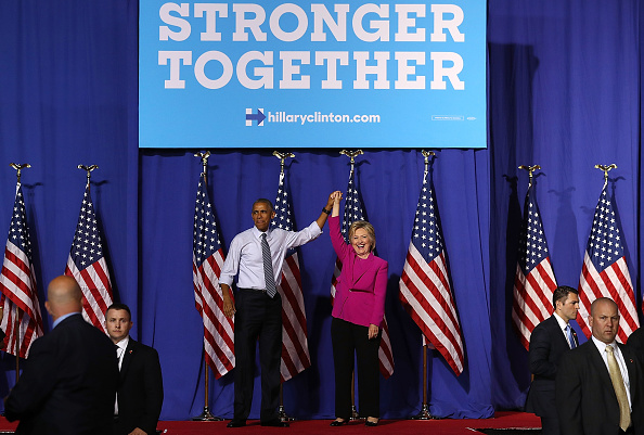 CHARLOTTE, NC - JULY 05: Democratic presidential candidate Hillary Clinton (R) and U.S. president Barack Obama during a campaign rally on July 5, 2016 in Charlotte, North Carolina. Photo by Justin Sullivan/Getty Images