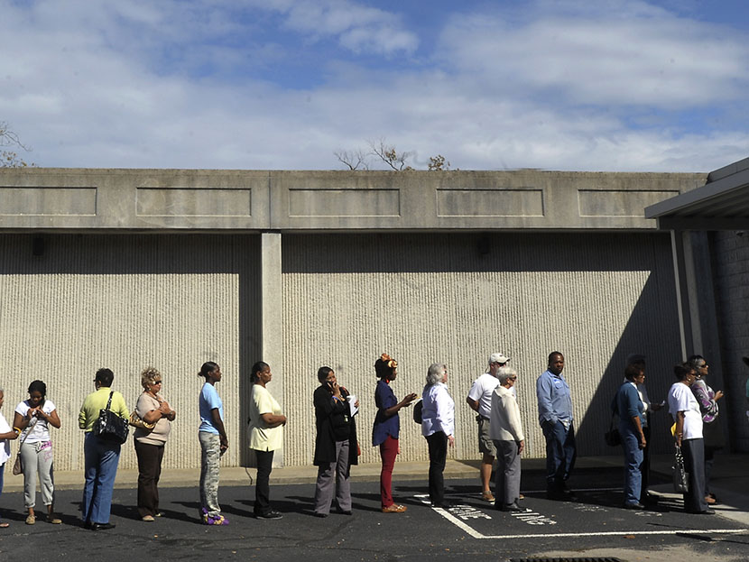 People wait in line to vote at the Board of Elections early voting site on October 18, 2012 in Wilson, North Carolina. Photo by Sara D. Davis/Getty Images