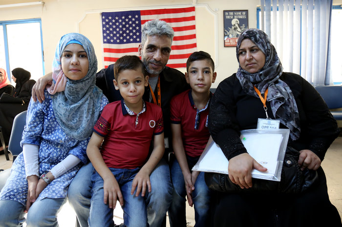 Five members of the Jouriyeh family, who are Syrian refugees headed to the U.S. from Jordan as part of a resettlement program. Photo credit: Raad Adayleh/AP