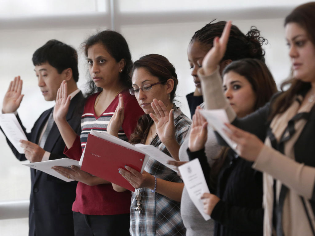 Newly naturalized Americans. Photo credit: LM OTERO/AP