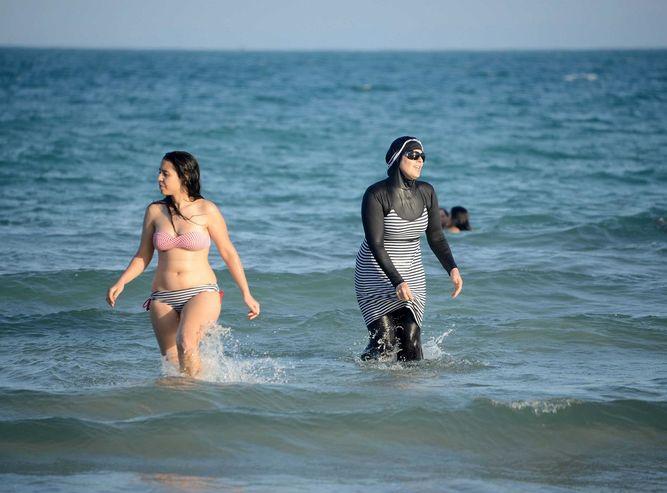 On the left a bikini, on the right a birkini. Photo credit: AFP/Fethi Belaid