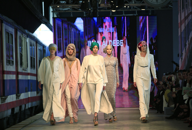 Models at Modest Fashion Week, in Istanbul. Photo credit: AP Photo/Lefteris Pitarakis