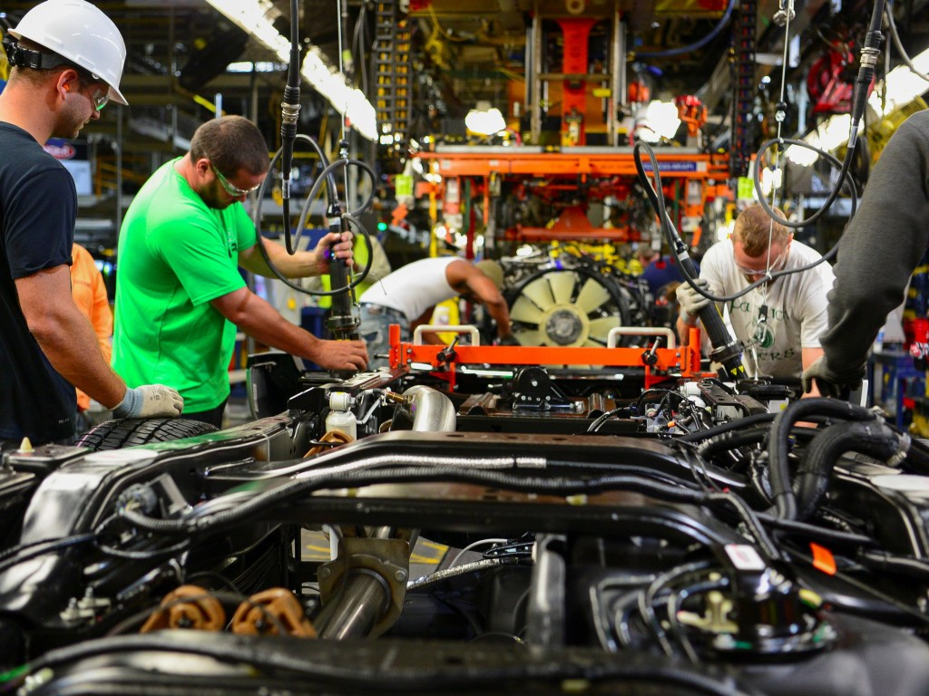 Workers assembling an auto at the Ford plant in Louisville.Photo credit: Bryan Woolston/Reuters