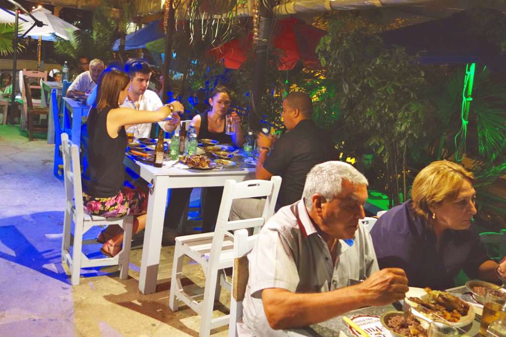 Tourists eating at a restaurant in Havana.