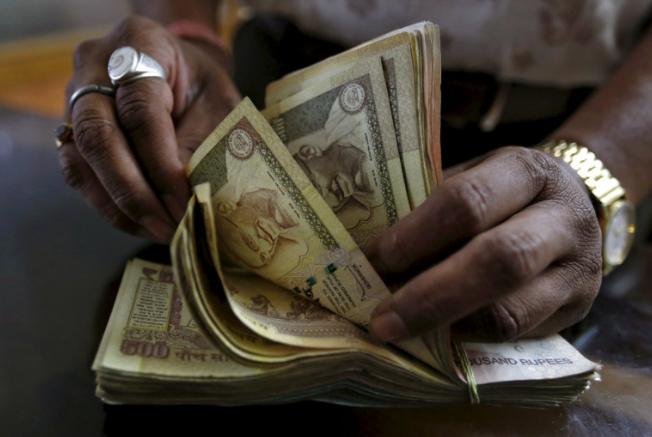 India's prime minister, Narendra Modi, announced a ban on the country's largest currency bills. Photo credit: Amit Dave/Reuters