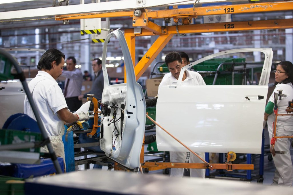 Workers in the Golf vehicle section of the Volkswagen factory in Puebla, Mexico. Photo credit: Brett Gundlock for The Globe and Mail.