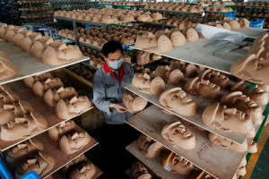 Masks of Trump at Jinhua Partytime Latex Art and Crafts Factory in Zhejiang Province, China.