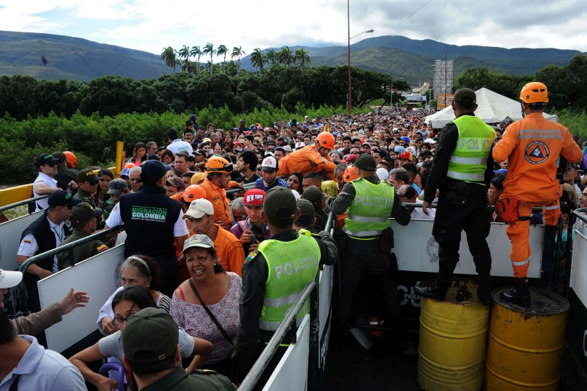 Venezuelans lining up to go into Colombia for food.