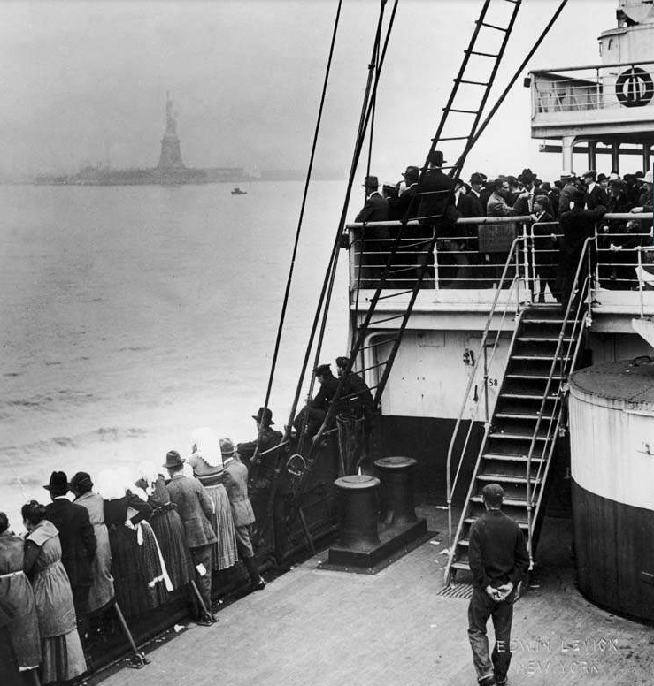 Immigrants view the Statue of Liberty while entering New York harbor New York City, around 1910. Photo credit: Edwin Levick/Getty Images)